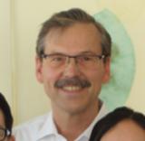 Herr Dr. Henning Platschek